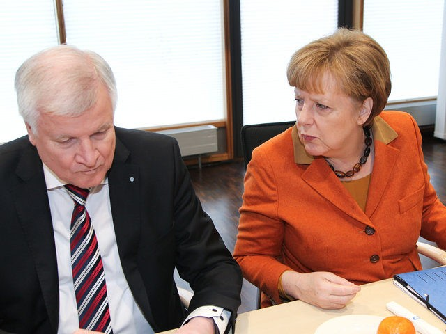 MUNICH, GERMANY - FEBRUARY 06: German Chancellor and Chairwoman of the German Christian Democrats (CDU) Angela Merkel (R) and Bavarian Governor and Chairman of the Bavarian Christian Democrats (CSU) Horst Seehofer (L) attend the future and joint presidency meeting of the CDU and CSU during the second day of a …