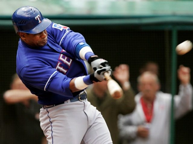 Texas Rangers' Sammy Sosa hits a solo home run off Cleveland Indians pitcher Paul Byrd in the top of the sixth inning of a baseball game Thursday, April 26, 2007, in Cleveland. Sosa set a major league record Thursday with home runs in his 44th ballpark at Jacobs Field. (AP …