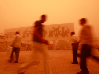 Iraqis walk through Tahrir Square during a heavy sandstorm in Baghdad, Iraq, Tuesday, May 22, 2012. The sandstorm prompted the shutdown of Baghdad's airport on Monday and brought travel complications for envoys trying to reach the Iraqi capital for nuclear talks between Iran and six world powers scheduled to begin …