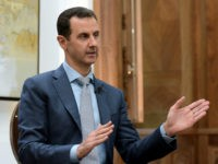 "In this photo released by the Syrian official news agency SANA, Syrian President Bashar Assad speaks during an interview with Yahoo News in Damascus, Syria, Friday, Feb. 10, 2017. Assad said, there are ""definitely"" terrorists among the millions of Syrians seeking refuge in the West. He said it doesn't have …"