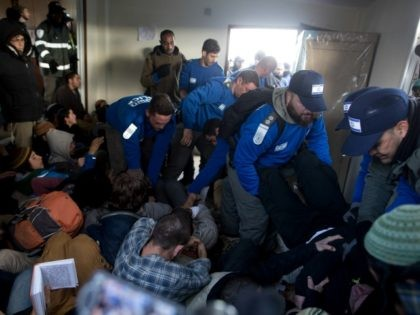 Israeli police scuffle with Israeli settlers as police take up positions in order to evacuate the settlers on February 1, 2017 in Amona, West Bank. Israeli Security forces have started evacuating residents from the illegal outpost of Amona in the West Bank on Wednesday, after hundreds of youths streamed into …