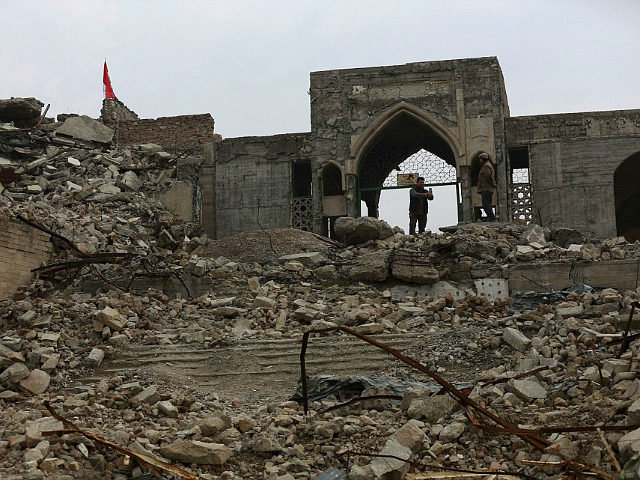 People inspect the destroyed Mosque of The Prophet Younis, or Jonah, in Mosul, Iraq, Saturday, Jan. 21, 2017. The revered Muslim shrine was destroyed on 2014 by Islamic State militants who overran the city and imposed their harsh interpretation of Islamic law. The mosque was built on an archaeological site dating back to 8th century BC, and is said to be the burial place of the prophet, who in stories from both the Bible and Quran is swallowed by a whale. (AP Photo/Khalid Mohammed)