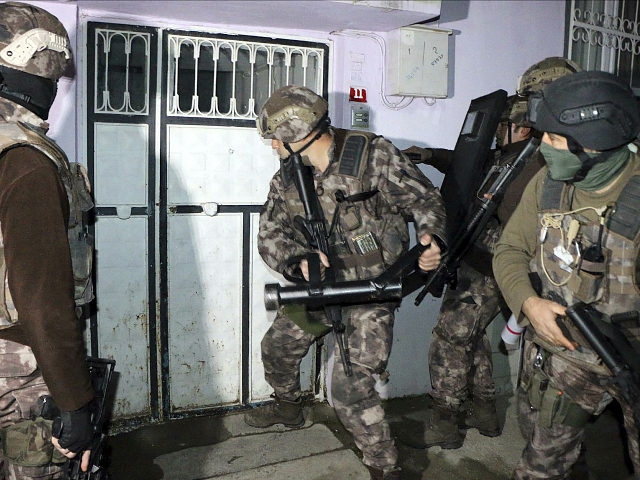 Turkish anti-terrorism police break a door during an operation to arrest people over alleged links to the Islamic State group, in Adiyaman, southeastern Turkey, early Sunday, Feb. 5, 2017. Turkey's state-run agency says anti-terrorism police have detained more than 400 people in simultaneous police operations that spanned several cities, including …