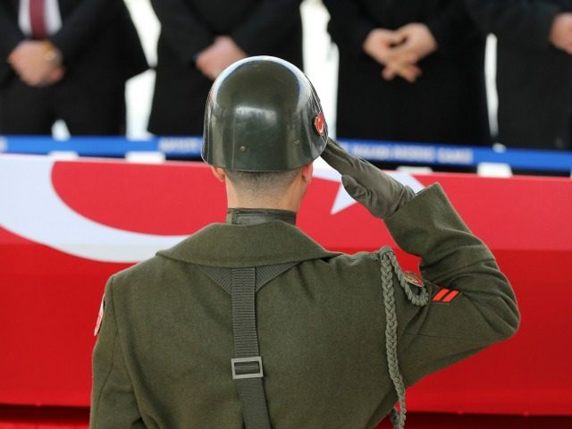 A military honour guard salutes in front of the coffin of Mahmut Uslu, one of five Turkish soldiers killed on Ferbuary 7, in an attack by IS militants around the Syrian town al-Bab, during his funeral ceremony in Ankara, on February 9, 2017. / AFP / ADEM ALTAN (Photo credit …