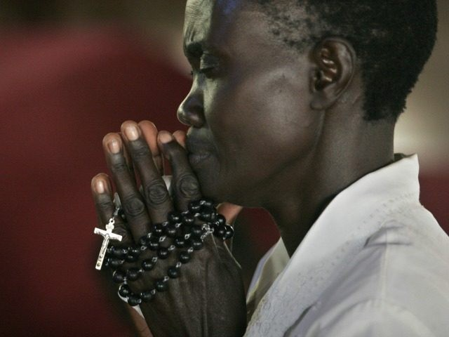 People from Kenya, Tanzania, Sudan, Rwanda and other East African countries arrive Thursday, June 2, 2005 at the Catholic Basilica Church of the Uganda Martyrs Namugongo, Uganda, a day before the Ugandan national Martyrs Day holiday. The basilica now stands on the location where 26 of the Buganda king's subjects were burned alive after refusing to renounce their Christian beliefs in 1886. Twenty two of the martyrs were canonized by Pope Paul VI in 1964.