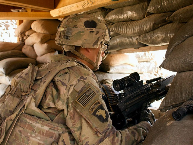 In this Sept. 8, 2016 photo, a U.S. Army soldier guards a position at Camp Swift, northern Iraq. U.S. troops will be engaged more closely than ever in fighting against Islamic State group militants as they back Iraqi forces in the long-anticipated assault on Mosul. The assault caps an increasing American role in Iraq over the past two years, with nearly 6,000 US troops on the ground, including special forces in combat on the front-lines. (AP Photo/Susannah George)