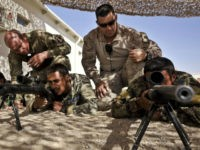 Troops in Afghanistan. British and American soldiers Corporal Christopher Smith, 29, from Glasgow, 4 Scots (left) and Gunnery Sergeant Victor Lopez, 38, from Los Angeles, US Marine Core (right), mentor Afghan National Army (ANA) soldiers from 3 Brigade 209 Kandak on marksmanship skills at ANA Camp Shorabak, Helmand Province, Afghanistan. …
