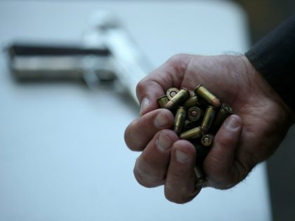 A San Francisco police officer holds a handful of ammunition that was surrendered during a gun buyback event on August 8, 2013 in San Francisco, California. Dozens of guns were turned in during a one-day gun buyback event in San Francisco's Mission District put on by San Francisco city officials. …