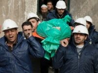 In this Wednesday, Sept. 16, 2015 file photo, comrades carry Ilias Mahmoud al-Taweel, a member of Syrian Civil Defence, or White Helmets, during his funeral in in Douma, the suburbs of Damascus. Taweel died while rescuing victims of the shelling of the city. A Syrian volunteer search-and-rescue group has launched …
