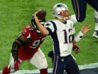 Tom Brady of the New England Patriots throws a pass against the Atlanta Falcons during Super Bowl 51, at NRG Stadium in Houston, Texas, on February 5, 2017
