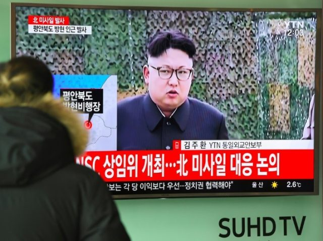 A man watches the news showing file footage of North Korean leader Kim Jong-Un at a railway station in Seoul on February 12, 2017