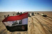 Iraqi forces advance near the village of Sheikh Younis, south of Mosul