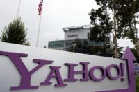 Yahoo has slashed the price of the sale of its core Internet business to Verizon by $350mn