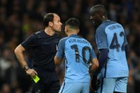 Manchester City midfielder Yaya Toure (R) and striker Sergio Aguero (C) remonstrate with the referee after Aguero was shown a yellow during the Champions League Round of 16 first-leg in Manchester, north west England on February 21, 2017