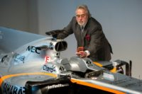 Sahara Force India team principal Vijay Mallya takes a picture of the VJM10 car at a launch event at the Silverstone motor racing circuit near Towcester, central England on February 22, 2017