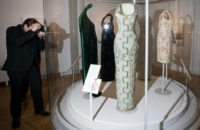 """A photographer takes pictures of dresses worn by Britain's Diana, Princess of Wales, during a preview of the forthcoming exhibition entitled """"Diana: Her Fashion Story"""", at Kensington Palace in London on February 22, 2017"""