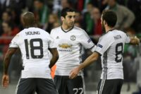 Manchester's United's Henrikh Mkhitaryan (C) celebrates with teammates after scoring a goal during their Europa League match against Saint-Etienne on February 22, 2017