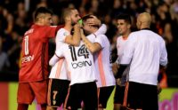 Valencia's players celebrates after their Spanish league football match against Real Madrid at the Mestalla stadium in Valencia on February 22, 2017