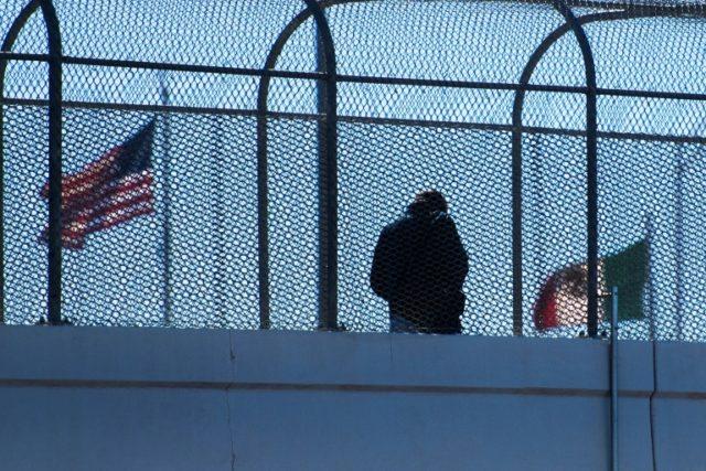 A man crosses the footbridge to Juarez, Mexico, from El Paso, Texas, on February 20, 2017