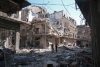 Residents search for survivors amid the rubble of a building following a reported air strike on Damascus' northeastern rebel-held al-Qaboun surburb, on February 24, 2017