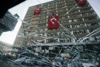 Turkish flags hang from the facade of the damaged Ankara police headquarters after it was bombed during the failed July 15 coup attempt, in a picture taken on July 19, 2016