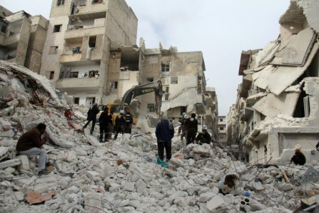 Syrian civil defence volunteers, known as the White Helmets, look for survivors amidst the debris following reported government airstrike on the Syrian town of Ariha, in the northwestern province of Idlib, on February 27, 2017