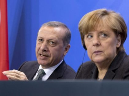 FILE - In this Feb. 4, 2014 file photo, German Chancellor Angela Merkel, right, listens as Turkish Prime Minister Recep Tayyip Erdogan, left, speaks during a joint news conference after a meeting at the chancellery in Berlin. Both leaders will meet again on Thursday, Feb. 2, 2017, in Ankara, Turkey, …