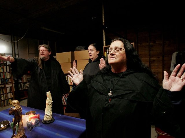 HOOPESTON, IL - OCTOBER 25: Wicca religion practitioners Rev. Don Lewis (L), Rev. Krystal High-Correll (C), and Rev. Virgina Powell HPS, participate in a Wiccan Lunar ritual in the temple at the Witch School October 25, 2006 in Hoopeston, Illinois. Wicca is a neo-Pagan religion which uses magic and nature …