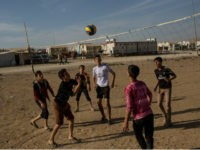 SHARYA, IRAQ - NOVEMBER 12: Yazidi boys play volleyball at an IDP camp for Yazidi people on November 12, 2016 in Sharya, Iraq. In 2014 thousands of Yazidi fled to IDP camps after ISIS took control of Sinjar and other Yazidi populated towns. Many Yazidi resettled in Mosul and Bashiqah …