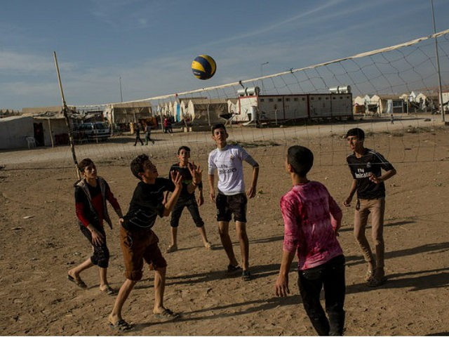 SHARYA, IRAQ - NOVEMBER 12: Yazidi boys play volleyball at an IDP camp for Yazidi people on November 12, 2016 in Sharya, Iraq. In 2014 thousands of Yazidi fled to IDP camps after ISIS took control of Sinjar and other Yazidi populated towns. Many Yazidi resettled in Mosul and Bashiqah but were forced to flee again when ISIS took control of the cities.The liberation of Bashiqah five days ago by the Iraqi army and the continuing Mosul offensive has given many Yazidi hope they will soon see the release of friends and family still held by ISIL. According to a United Nations report ISIL still held 1,935 Yazidi women, as well as 1,864 Yazidi men and recent reports say at least 300 Yazidi women remain inside Mosul. (Photo by Chris McGrath/Getty Images)