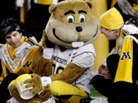 Minnesota mascot Goldie Gopher, center, performs with members of the marching band during the second half of a NCAA college football game, Saturday Oct. 30, 2010 in Minneapolis. Ohio State won 52-10. (AP Photo/Paul Battaglia)