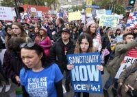 Thousands of people take part in the ``Free the People Immigration March,'' to protest actions taken by President Donald Trump and his administration, in Los Angeles Sunday, Feb. 18, 2017. March and rally organizers are calling for an end to ICE raids and deportations, minority killings by police and that …