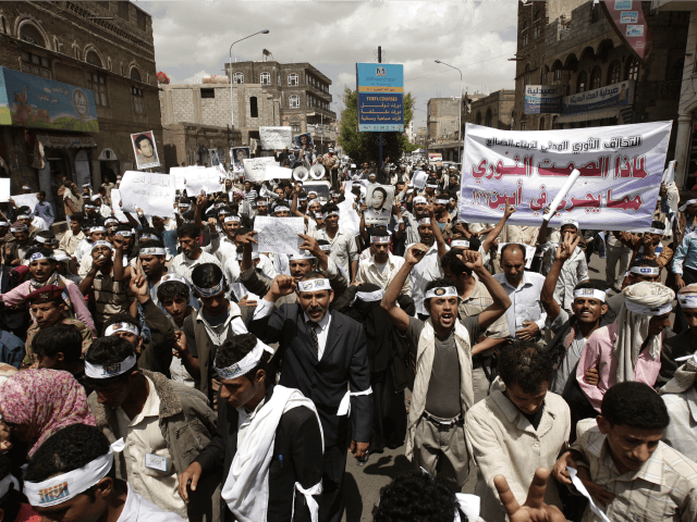 In this April 23, 2012, file photo Yemeni members of the Peaceful Revolution Salvation Front chant slogans during a demonstration demanding independence of the judicial system from government control in Sanaa, Yemen. Yemen's al-Qaida of the Arabian Peninsula (AQAP) is becoming a major draw for foreign fighters as it carves …