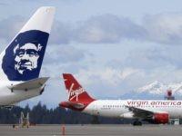 Alaska Airlines and Virgin America (Ted S. Warren / Associated Press)