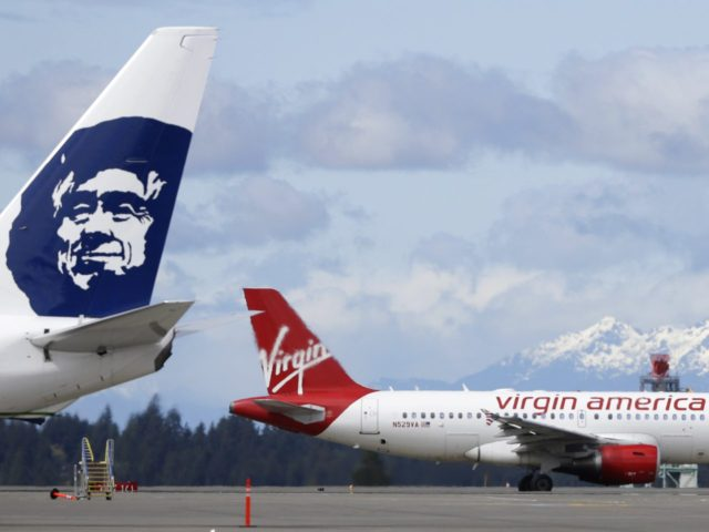 Alaska Airlines and Virgin America (Ted S. Warren / Associated Press)