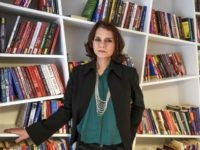 Turkish novellist Asli Erdogan poses during an interview on February 8, 2017 in Istanbul. Internationally acclaimed Turkish novelist Asli Erdogan is still haunted by 'the shadow of prison' where she spent over four months, fearing it could begin again any time. But the writer insists she will not stay silent, …