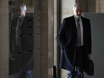 Syrian chief negotiator Bashar al-Ja'afari, Ambassador of the Permanent Representative Mission of Syria to UN New York, arrives to attend a meeting of Intra Syria peace talks at the European headquarters of the United Nations in Geneva, Switzerland, on Thursday, March 2, 2017. (Philippe Desmazes/Pool Photo via AP)