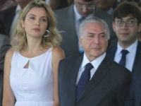 Brazil's President Michel Temer, center, and wife Marcela Temer, watch an Independence Day military parade in Brasilia, Brazil, Wednesday, Sept. 7, 2016. Pictured right is Lower House Speaker Rodrigo Maia. (AP Photo/Eraldo Peres)