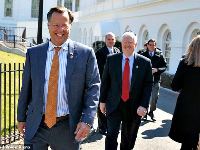 House Freedom Caucus member Rep. Dave Brat, R-Va., arrives at the White House, Thursday, March 23, 2017, in Washington. (AP Photo/Evan Vucci)