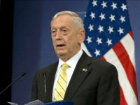 FILE - In this Feb. 16, 2017 file photo, Defense Secretary Jim Mattis speaks in Brussels. Mattis is not lonely in the Pentagon, but two months into his tenure as secretary of defense not a single political appointee has joined him. The retired Marine general, who took office just hours …