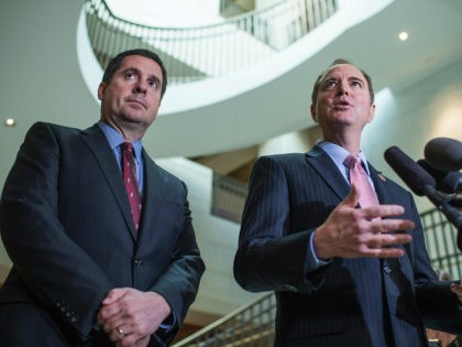 UNITED STATES - MARCH 2: Rep. Adam Schiff, D-Calif., right, ranking member of the House Permanent Select Committee on Intelligence, and Chairman Devin Nunes, R-Calif., conduct a news conference in the Capitol Visitor Center after a briefing with FBI Director James Comey about Russia, March 2, 2017. (Photo By Tom …