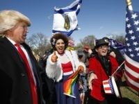 Gays for Trump rally with Joy Villa (Supporters of President Donald Trump, from left, comedian Dustin Gold from Nashville Tenn., singer Joy Villa and fashion designer Andre Soriano, cheer during a rally organized by the North Carolina-based group Gays for Trump, at the National Mall near the Washington Monument in Washington, Saturday, March 4, 2017. The speakers at the rally talked about immigration, gay rights, and several other issues and later marched from the National Mall to the White House. (AP Photo/Manuel Balce Ceneta / Associated Press)
