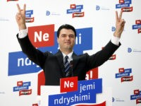 "Lulzim Basha, the newly elected leader of the Democratic Party (DP), soon to be in opposition after the June 23rd general elections, flashes ""V for victory"" signs during a press conference in Tirana on July 23, 2013. Basha won with 80 percent of the votes an internal race for the …"
