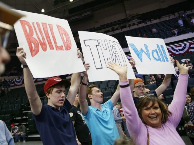 TAMPA, FL - FEBRUARY 12: People hold signs that read, ' Build that Wall', as they wait for the start of a campaign rally for Republican presidential candidate Donald Trump at the University of South Florida Sun Dome on February 12, 2016 in Tampa, Florida. The process to select the …