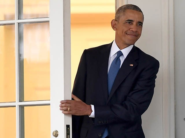 US President Barack Obama departs the Oval Office for the last time as president, at the White House in Washington, DC January 20, 2017. / AFP / JIM WATSON (Photo credit should read JIM WATSON/AFP/Getty Images)