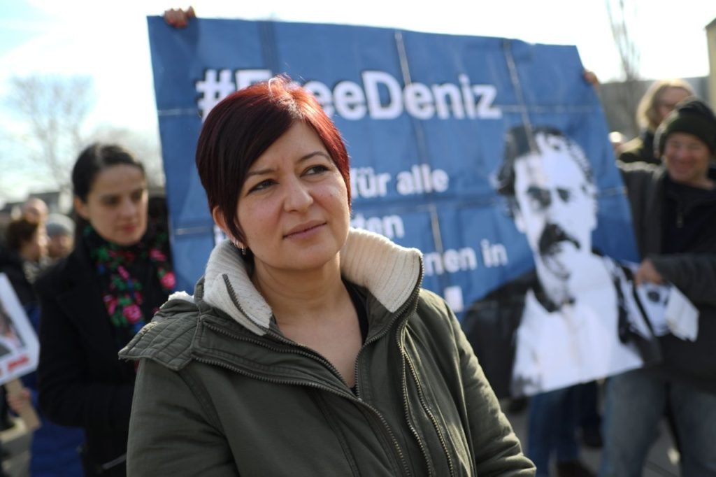 Ilkay Yucel (L), the sister of journalist Deniz Yucel detained in Turkey, takes part in a protest in support of her brother on February 25, 2017 in Floersheim near Frankfurt am Main, western Germany. Dozens of German lawmakers on February 24, 2017 called on Turkey to release the journalist for the German Die Welt newspaper who is being held on terrorism-related charges. The German daily said its correspondent Deniz Yucel, 43, was detained on February 18 and his apartment searched in connection with news reports on an attack by hackers on the email account of Turkey's energy minister. Yucel originates from Floersheim. / AFP / dpa / Andreas Arnold / Germany OUT        (Photo credit should read ANDREAS ARNOLD/AFP/Getty Images)