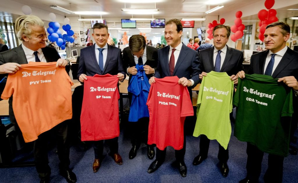 Party leaders Geert Wilders (PVV), Emile Roemer (SP), Mark Rutte (VVD), Lodewijk Asscher (PvdA), Alexander Pechtold (D66) and Sybrand van Haersma Buma (CDA) visit the newsroom of Dutch daily newspaper De Telegraaf, on March 5, 2017 in Amsterdam. Anti-Islam Dutch politician Geert Wilders brushed off a slump in polls on March 5, 2017, saying he was confident of a strong showing in upcoming elections, which he vowed would also boost Europe's far-right. Just 10 days before the March 15 vote, the firebrand politician and his Freedom Party (PVV) appears to have slipped into second place behind the Liberal party of incumbent Prime Minister Mark Rutte after months of leading the opinion polls. / AFP PHOTO / ANP / Remko de Waal / Netherlands OUT (Photo credit should read REMKO DE WAAL/AFP/Getty Images)