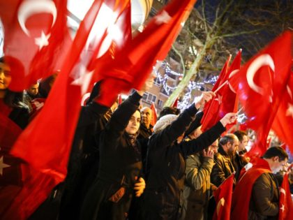 Dutch Turkish demonstrators hold Turkish flags as they gather outside the Turkish consulate in Rotterdam, on March 11, 2017 after Netherlands refused Turkish Foreign Minister Mevlut Cavusoglu permission to land for a rally to gather support for a referendum on boosting Turkish president Erdogan's powers. Turkey promised to avoid the …