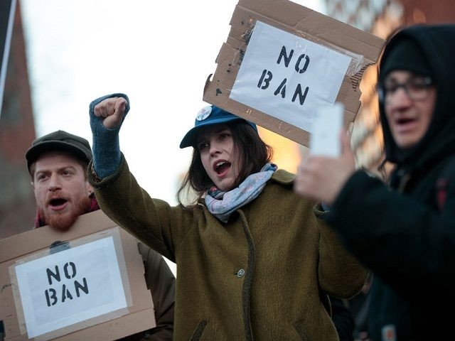 NEW YORK, NY - MARCH 16: Demonstrators rally during a small protest of President Donald Trump's proposed travel ban and suspension of the country's refugee program, March 16, 2017 in New York City. On Wednesday night, a federal judge in Hawaii issued a temporary restraining order on President Trump's second …
