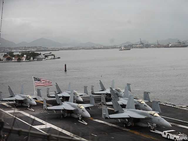 Partial view of the flight deck of the USS Carl Vinson (CVN-70) Nimitz class aircraft supercarrier, at anchor in Guanabara Bay, Rio de Janeiro, Brazil, on February 26, 2010. The Carl Vinson arrives from Haiti, where she took part in Operation Unified Response, providing military support capabilities to civil authorities …